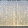 Rückwand mit Abdeckstoff für Hintergrund auf Hochzeit mit LED Lichterketten Stoff Beleuchtung mieten und leihen Wand Abdecken StasEvents