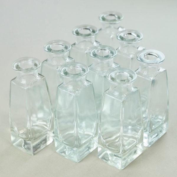 Fläschchen eckig für BLumen tischdeko aus glas mieten 1